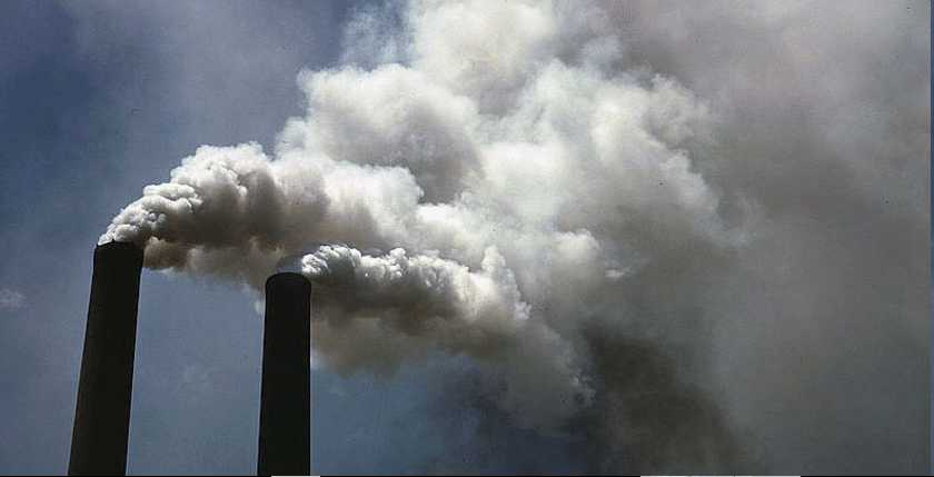 chimneys pouring out smoke