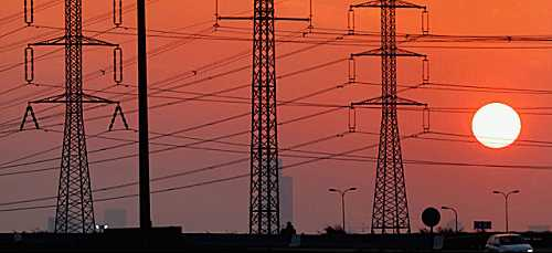 Power transmission lines at sunset