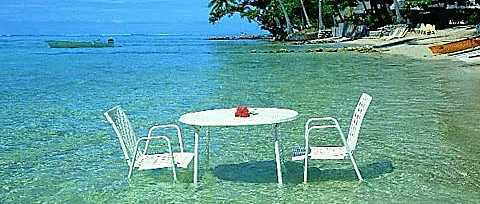 picnic table and chairs set up in the sea